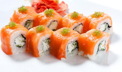 Sushi roll with red fish closeup