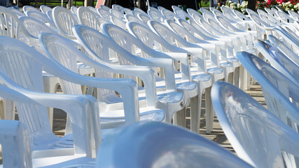 Array of empty white chairs