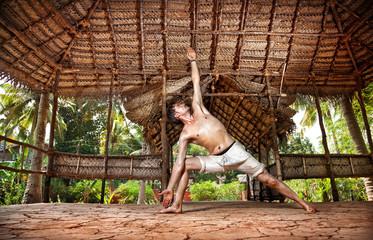 Yoga man in Indian shala