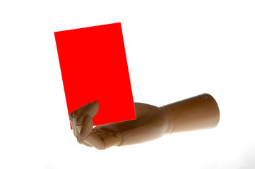a wooden hand is holding a red card