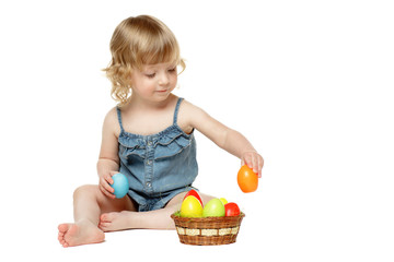 Little girl sitting on the floor with Easter eggs