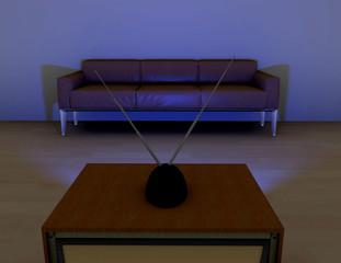 Sofá delante de un televisor,viendo televisión.