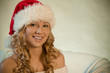 Portrait of a beautiful young woman in santa hat
