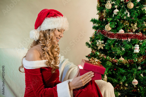 Portrait of a beautiful woman next to Christmas Tree