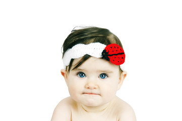 Portrait of a cute little baby on a white background