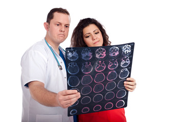 Confused doctors looking at computed tomography (CT)