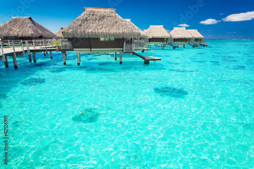 Water villas in the ocean with steps into lagoon