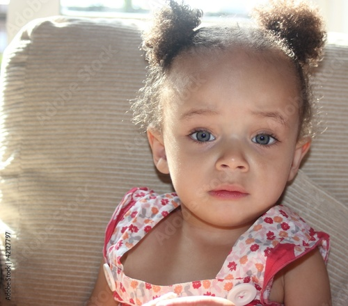 Pretty Blue eyed ethnic baby girl with bunches
