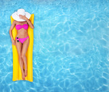 Summer leisure, girl relaxing in a pool