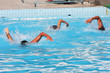 Men playing water polo in swimming pool