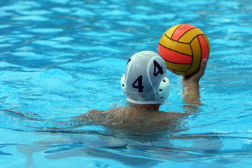 Water polo player holding a ball