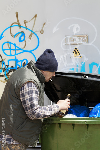 Tramp digging in dumpster