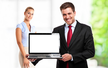 Businessman showing a laptop