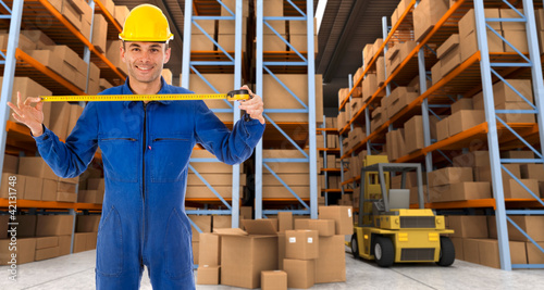 Warehouse worker with tape measure b