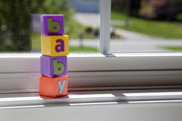 Baby block on the window