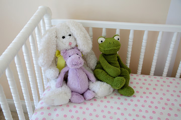 Stuffed animals in the crib