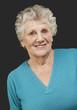 portrait of senior woman standing over black background