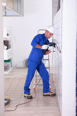 Tradesman using a power drill