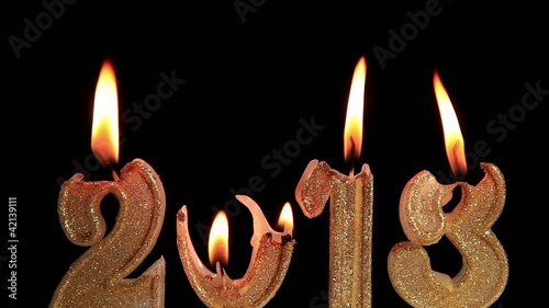 Happy New Year 2013, candles burning, time lapse, reversing