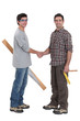 Carpenters shaking hands