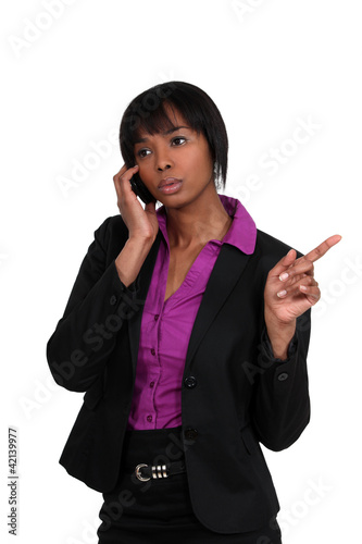 beautiful black woman on the phone pointing sideways