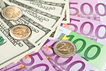 Many euro and dollar banknotes and coins