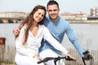 Couple cycling to edge of river