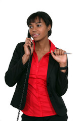 Office worker holding pen during phone call