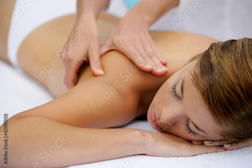 Girl having a back massage