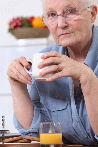 Senior woman with a cup of tea