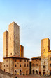 San Gimignano sunset, towers in central square. Tuscany Italy