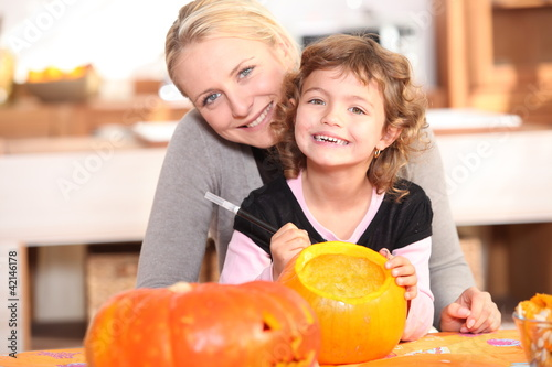 Mother and daughter pumpkin carving