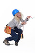 Electrocuted tradeswoman holding a multitester