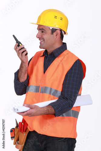 Happy architect communicating via radio