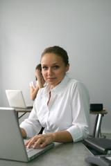 Businesswoman sat at her desk