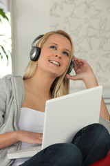 Teen with headphones and computer
