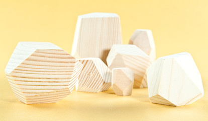 Wooden blocks Tumi-ishi on yellow background