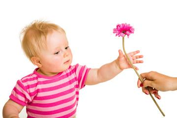 Infant girl giving flower