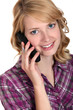Attractive woman talking on the telephone