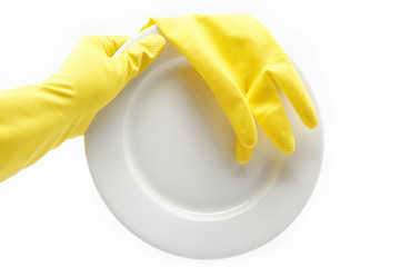 Hand in rubber glove with a plate on a white background.