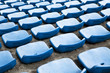 blue ordered rubber seats in a sports track field