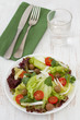 vegetable salad on the plate and glass of water