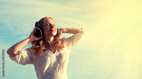 beautiful girl listening to music on headphones