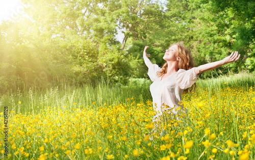 Leinwanddruck Bild beautiful girl enjoying the summer sun