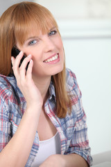 Red-haired woman with mobile phone