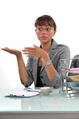 Businesswoman with confused look on her face