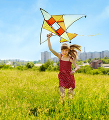 Child flying kite outdoor.