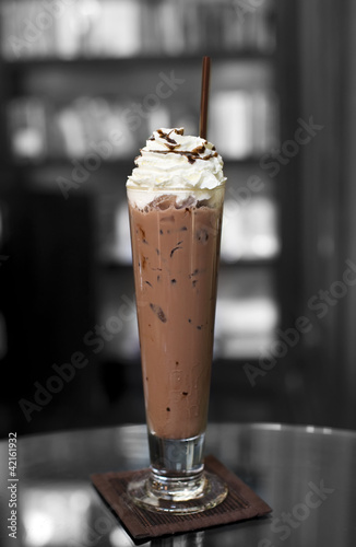 Ice chocolate on top with whip cream