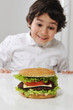 Little Arabic boy with burger