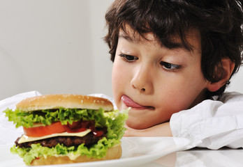 Boy on temptation with burger